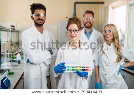 Jóvenes químico estudiante de trabajo laboratorio productos químicos Foto stock © Elnur