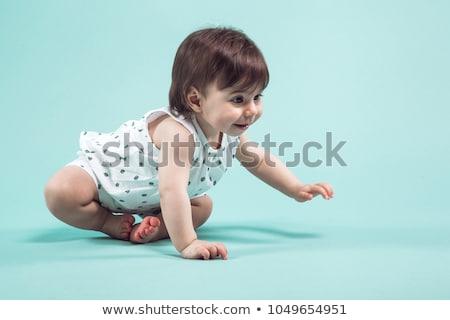 Aranyos kicsi lány kúszás ül stúdió Stock fotó © Traimak