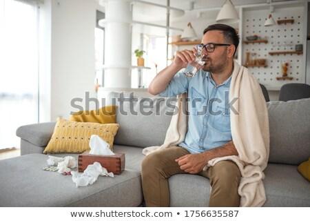 doente · moço · sofrimento · gripe · casa · sofá - foto stock © andreypopov