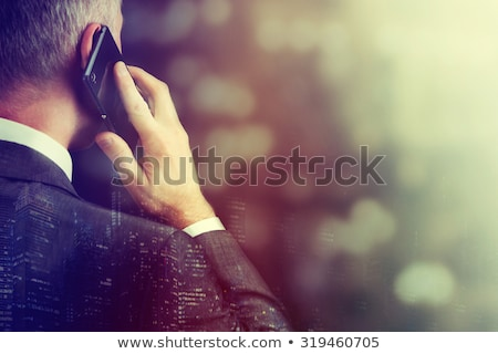 boss chief executive talking on mobile phone stock photo © robuart