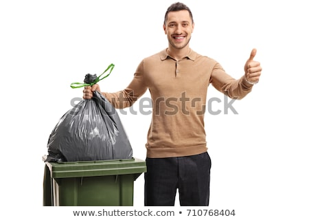 man throwing a garbage bag into a dumpster Stock photo © nito