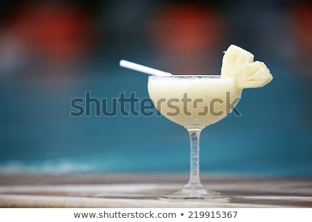 Glass of pinacolada cocktail standing on the  Stock photo © dashapetrenko
