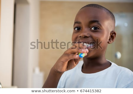 boys brushing and cleaning in bathroom stock photo © colematt