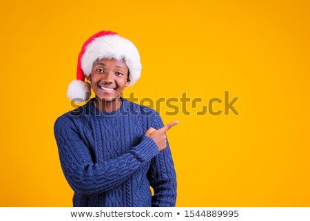 surprised young man wearing plaid shirt stock photo © deandrobot