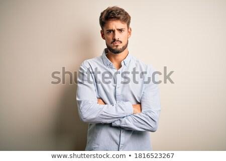 Ideges elégedetlen fiatal szakállas férfi áll Stock fotó © deandrobot