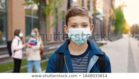close up of a smiling young girl with backpack stock photo © deandrobot