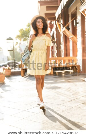 full length photo of young american woman 20s wearing straw hat stock photo © deandrobot