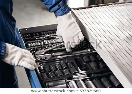 Autószerelő tart dolgozik szerszámok szerszámosláda szerelő Stock fotó © Kzenon