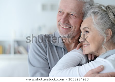 Portrait of happy couple man and woman smiling and resting in li Stock photo © deandrobot