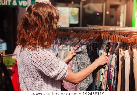 women choosing clothes at vintage clothing store stock photo © dolgachov