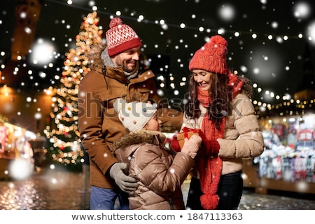 happy woman over christmas tree in tallinn Stock photo © dolgachov