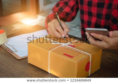 Man seller write a order product to prepare for delivery to cust Stock photo © Freedomz