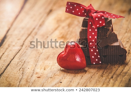 close up of red heart shaped chocolate candies Stock photo © dolgachov