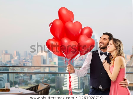 couple with heart shaped balloons in singapore Stock photo © dolgachov
