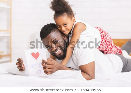 Stock photo: Father Kissing Her Daughter On Bed