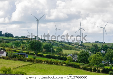 Scene with wind energy from windmills Stock photo © bluering