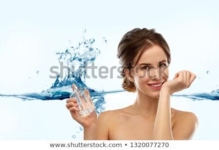 happy woman with perfume over water splash Stock photo © dolgachov