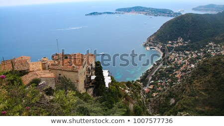 Historic village of Eze on stone cliff above Cote d Azur Stock photo © xbrchx