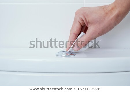 man flushing the toilet protected with paper Stock photo © nito