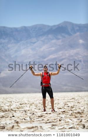 Hiker Holding Poles Against Mountain Stock photo © Maridav