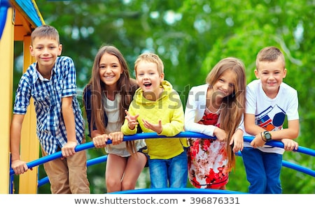 Kids have fun, recreation outdoors at summer, boy playing with sand in sandbox under umbrella Stock photo © robuart