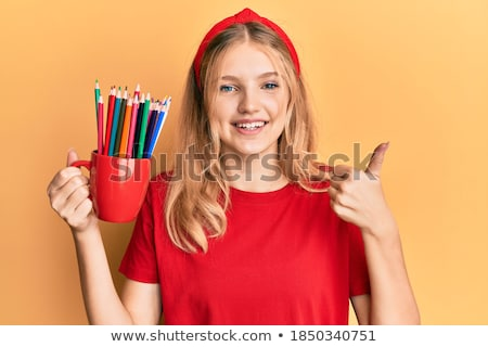 woman showing a thumbs up and pencil stock photo © ilolab