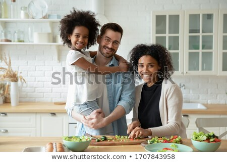 portrait of happy family looking at camera and prepared for chri stock photo © dacasdo