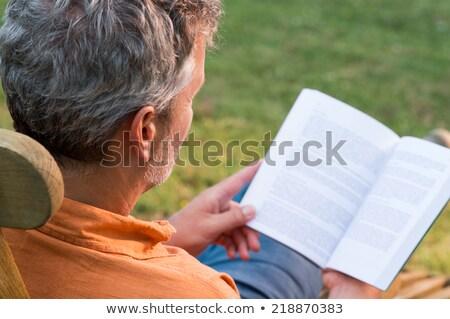 senior · man · lezing · gras · boek · bomen - stockfoto © photography33