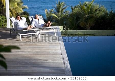 vrouw · slapen · zwembad · jonge · mooie · vrouw · water - stockfoto © dash
