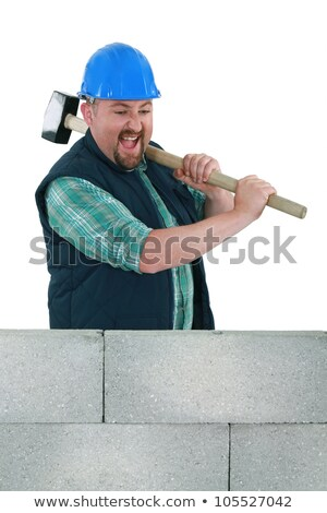 Angry builder about to smash wall Stock photo © photography33