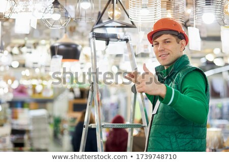 Construction worker standing next to a civil engineer Stock photo © photography33