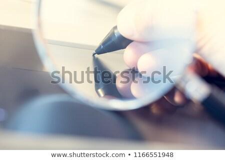 üzletember · zárt · vizsgálat · nagyító · arc · igazgató - stock fotó © RTimages