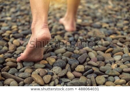 A piedi nudi rock giovane spiaggia uomo sole Foto d'archivio © luissantos84