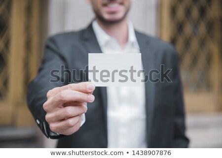 primo · piano · imprenditore · bianco · carta · isolato - foto d'archivio © wavebreak_media