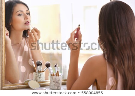 the fashion girl applying lipstick stock photo © carlodapino
