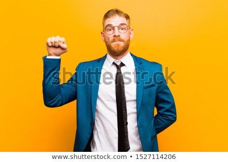 Genç işadamı yukarı beyaz ofis gülümseme Stok fotoğraf © wavebreak_media