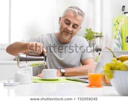 mature man having breakfast stock photo © photography33