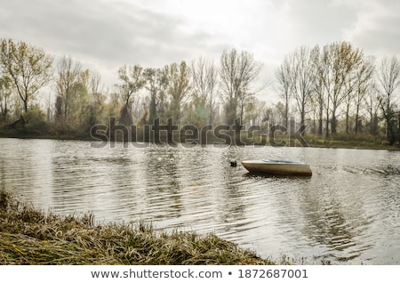 alone fishing boat on danube river Stock photo © mady70