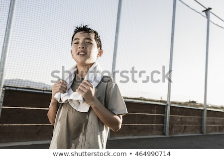 sweating boy after sport looks confident Stock photo © meinzahn