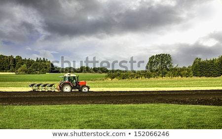 Small scale farming with tractor and plow   Stock photo © meinzahn