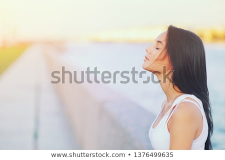 Side profile of an Asian young woman day dreaming Stock photo © bmonteny