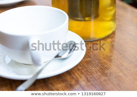 oolong tea in ceramic cup and empty wooden spoons stock photo © punsayaporn