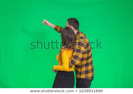 handsome man embracing his lover while looking at the camera the woman is laughing stock photo © feedough
