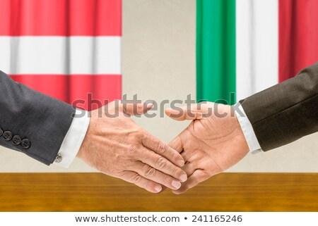Representatives of Austria and Italy shake hands Stock photo © Zerbor
