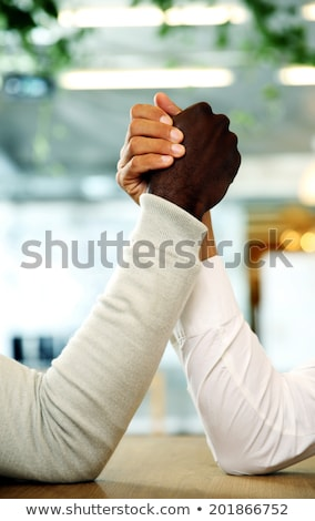closeup portrait of arms grappled in fight stock photo © deandrobot