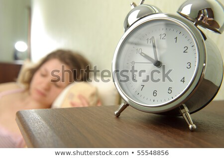 Young girl and alarm clock. Bedtime scene  Stock photo © Nobilior