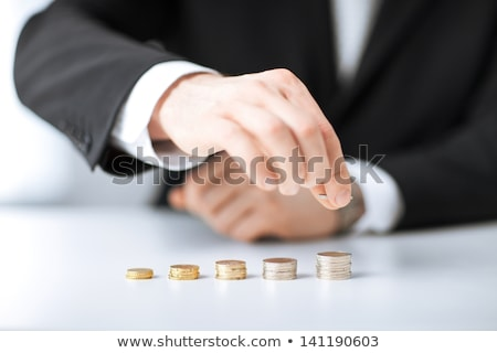 stack of coins in one row Stock photo © dolgachov