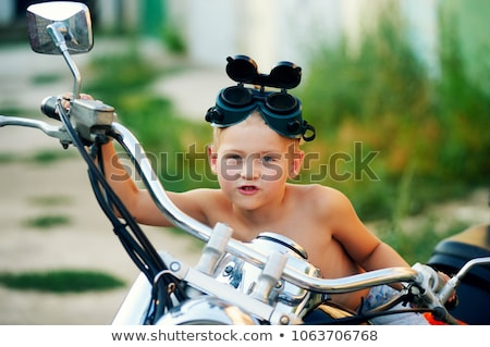 Baby boy playing with his bike Stock photo © igabriela
