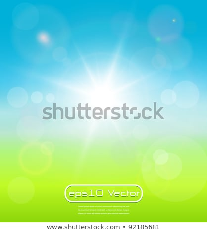 blurry background spring or summer blue sky with glaring sun stock photo © netkov1