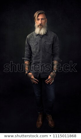 rocker posing in dark studio with hand in pocket  Stock photo © feedough